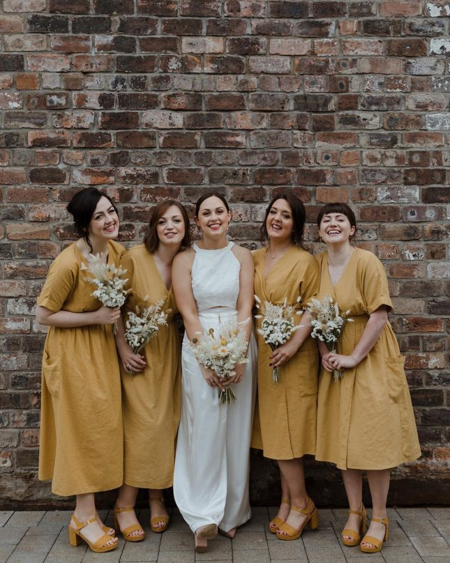 yellow bridesmaids dreses with all white floral bouquets