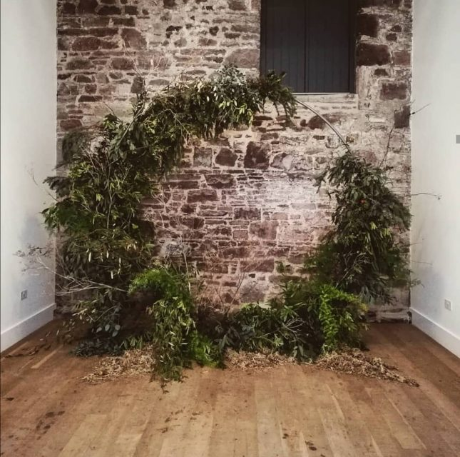 foraged foliage wreath wedding backdrop