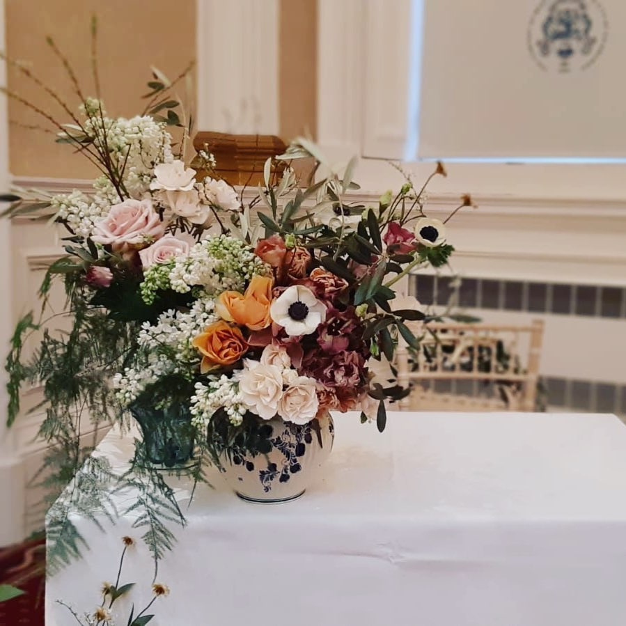 neutral wedding arrangement at altar